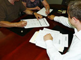 Wilson Law Firm signing documents for loan